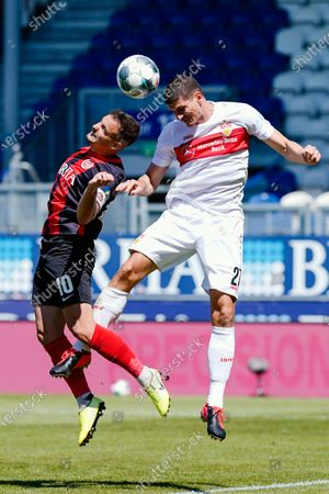 Wiesbaden's Sebastian Mrowca (L) and Stuttgart's Mario Gomez in action during the German Bundesliga second division soccer match between SV Wehen Wiesbaden and VfB Stuttgart in Wiesbaden, Germany, 17 May 2020. The Bundesliga and Second Bundesliga is the first professional league to resume the season after the nationwide lockdown due to the ongoing Coronavirus (COVID-19) pandemic. All matches until the end of the season will be played behind closed doors.