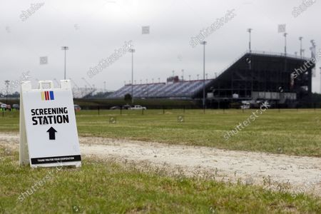 Sign directs people to a screening station outside Darlington Raceway, in Darlington, S.C. NASCAR, which has been idle since March 8 because of the coronavirus pandemic, makes its return with the Real Heroes 400 Nascar Cup Series auto race Sunday
