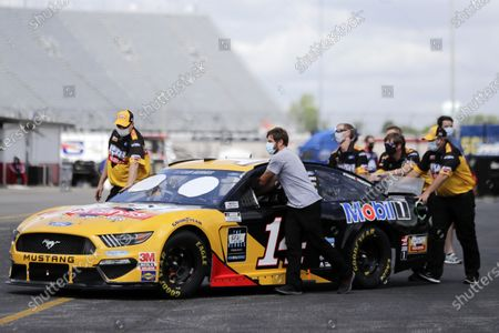 The car of Clint Bowyer is pushed through the infield before the Real Heroes 400 NASCAR Cup Series auto race, in Darlington, S.C