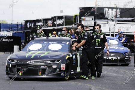 The car of Kurt Busch is pushed through the infield before the Real Heroes 400 NASCAR Cup Series auto race, in Darlington, S.C