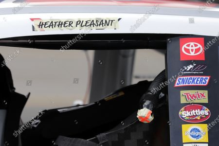 The name of Heather Pleasant is displayed over the name of driver Kyle Busch on Busch's car before the Real Heroes 400 NASCAR Cup Series auto race, in Darlington, S.C. The names of health care workers across the country have been substituted for the drivers' name above the door on each of the 40 cars