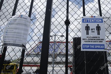 Social distancing guidelines are posted at Darlington Raceway, in Darlington, S.C. NASCAR, which has been idle for 10 weeks because of the coronavirus pandemic, makes its return with the Real Heroes 400 Nascar Cup Series auto race Sunday