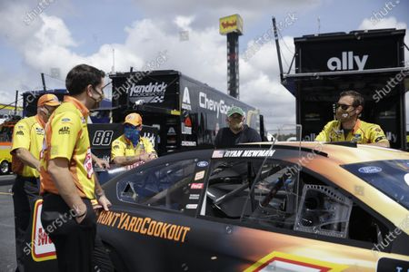 Crew members for driver Ryan Newman wait with his car before the NASCAR Cup Series auto race, in Darlington, S.C