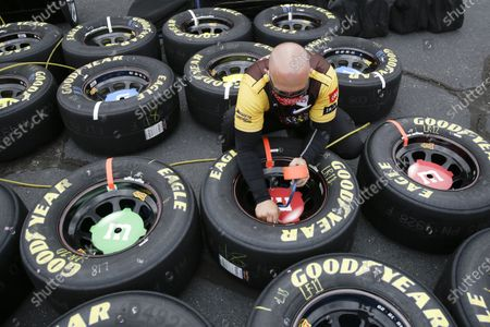 Tires for driver Kyle Busch are prepared before the NASCAR Cup Series auto race, in Darlington, S.C