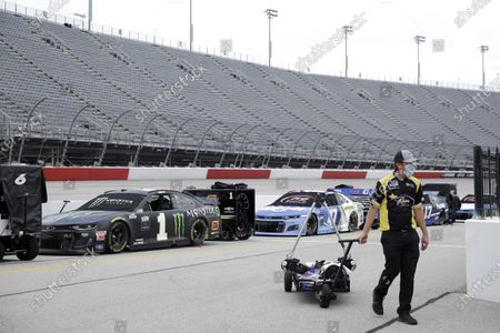 Crew member for driver Quin Houff walks down pit row before the start of the NASCAR Cup Series auto race, in Darlington, S.C