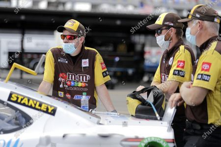 Crew members for driver Kyle Busch wait with his car before the start of the NASCAR Cup Series auto race, in Darlington, S.C
