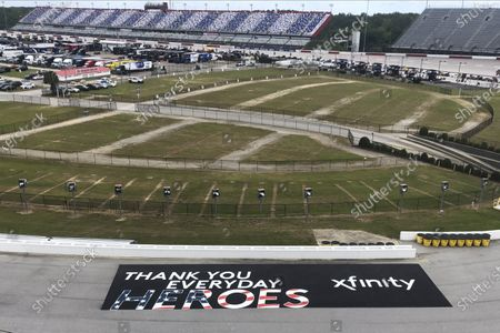 Sign thanking people working during the coronavirus pandemic is displayed in a turn at Darlington Raceway, in Darlington, S.C. NASCAR, which has been idle for 10 weeks because of the pandemic, makes its return with the Real Heroes 400 Nascar Cup Series auto race Sunday