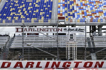The grandstands are empty at Darlington Raceway before the NASCAR Cup Series auto race, in Darlington, S.C