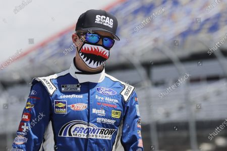 Driver Michael McDowell walks to his car before the start of the NASCAR Cup Series auto race, in Darlington, S.C