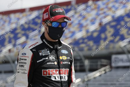 Driver Brad Keselowski walks to his car for the start of the NASCAR Cup Series auto race, in Darlington, S.C