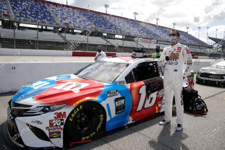Kyle Busch stands for the playing of the national anthem before the start of the NASCAR Cup Series auto race, in Darlington, S.C