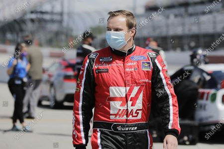 Driver Cole Custer walks to his car for the start of the NASCAR Cup Series auto race, in Darlington, S.C