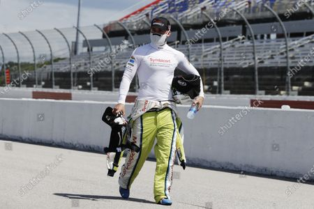 Driver Austin Dillon walks to his car for the start of the NASCAR Cup Series auto race, in Darlington, S.C