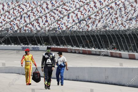 Drivers walk to their cars for the start of the NASCAR Cup Series auto race, in Darlington, S.C