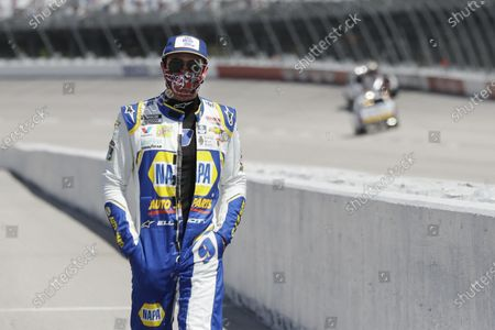 Driver Chase Elliott walks to his car for the start of the NASCAR Cup Series auto race, in Darlington, S.C