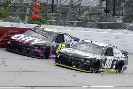 Jimmie Johnson (48) and Alex Bowman (88) come down a straightaway during the NASCAR Cup Series auto race, in Darlington, S.C