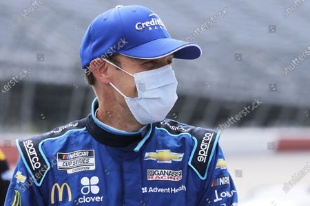 Matt Kenseth waits for the start of the NASCAR Cup Series auto race, in Darlington, S.C