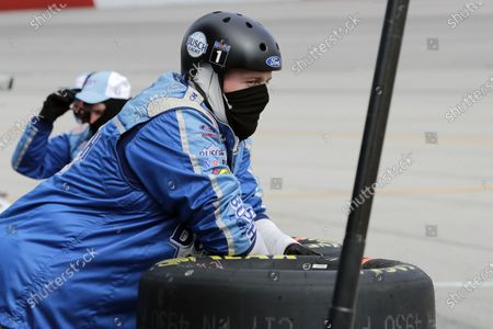 Crew member for driver Kevin Harvick watches during the NASCAR Cup Series auto race, in Darlington, S.C