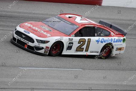 Matt DiBenedetto (21) drives during the NASCAR Cup Series auto race, in Darlington, S.C