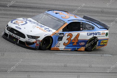 Michael McDowell (34) drives during the NASCAR Cup Series auto race, in Darlington, S.C
