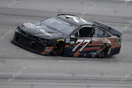 Reed Sorenson (77) drives during the NASCAR Cup Series auto race, in Darlington, S.C