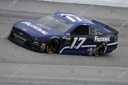 Chris Buescher (17) drives during the NASCAR Cup Series auto race, in Darlington, S.C