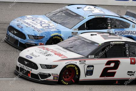 Kevin Harvick (4) and Brad Keselowski (2) compete during the NASCAR Cup Series auto race, in Darlington, S.C