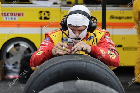 Tires for driver Brad Keselowski are checked during the NASCAR Cup Series auto race, in Darlington, S.C