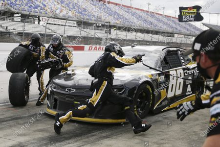 Alex Bowman (88) makes a pit stop during the NASCAR Cup Series auto race, in Darlington, S.C