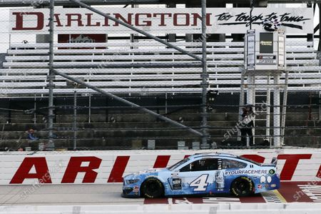 Kevin Harvick (4) crosses the finish line to win the NASCAR Cup Series auto race, in Darlington, S.C