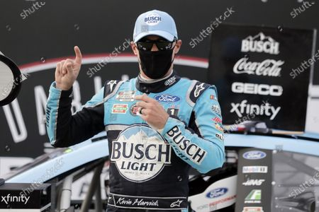 Kevin Harvick celebrates after winning the NASCAR Cup Series auto race, in Darlington, S.C