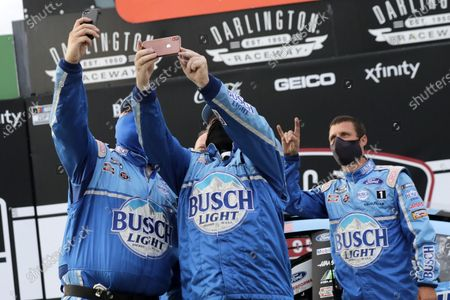 Members of Kevin Harvick's team celebrate after winning the NASCAR Cup Series auto race, in Darlington, S.C