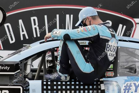 Kevin Harvick gets out of his car in victory lane after winning the NASCAR Cup Series auto race, in Darlington, S.C