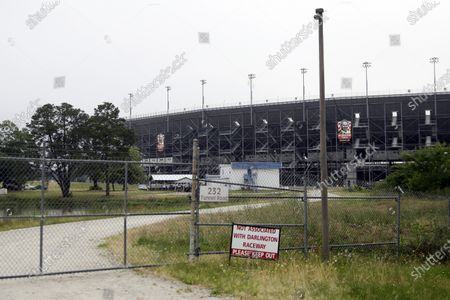 Gate is locked outside Darlington Raceway, in Darlington, S.C. NASCAR, which has been idle since March 8 because of the coronavirus pandemic, makes its return at the track with the Real Heroes 400 Nascar Cup Series auto race Sunday