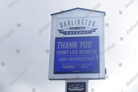 Sign at Darlington Raceway displays a message thanking front-line workers, in Darlington, S.C. NASCAR, which has been idle since March 8 because of the coronavirus pandemic, makes its return with the Real Heroes 400 Nascar Cup Series auto race Sunday