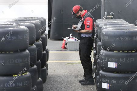 Worker checks tires in the infield before the Real Heroes 400 NASCAR Cup Series auto race, in Darlington, S.C. NASCAR, which has been idle for 10 weeks because of the coronavirus pandemic, makes its return at the track Sunday