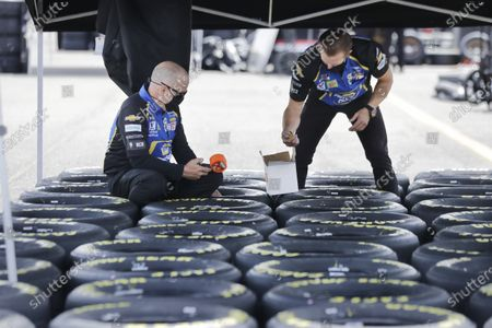 Tires are prepared before the Real Heroes 400 NASCAR Cup Series auto race, in Darlington, S.C. NASCAR, which has been idle for 10 weeks because of the coronavirus pandemic, makes its return at the track Sunday