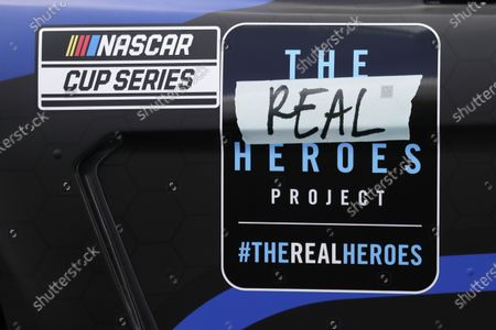 Decal bearing the name of the Real Heroes 400 NASCAR Cup Series auto race is displayed on the car of driver Chris Buescher, in Darlington, S.C. NASCAR, which has been idle for 10 weeks because of the coronavirus pandemic, makes its return at the track Sunday