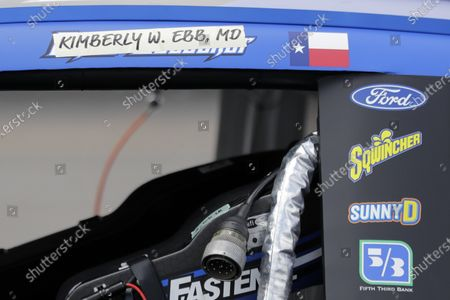 The name of Dr. Kimberly W. Ebb is displayed over the name of driver Chris Buescher on Buescher's car before the Real Heroes 400 NASCAR Cup Series auto race, in Darlington, S.C. The names of health care workers across the country have been substituted for the drivers' name above the door on each of the 40 cars