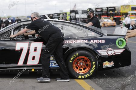 The car of BJ McLeod is pushed through the infield before the Real Heroes 400 NASCAR Cup Series auto race, in Darlington, S.C