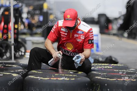 Tires are prepared before the Real Heroes 400 NASCAR Cup Series auto race, in Darlington, S.C