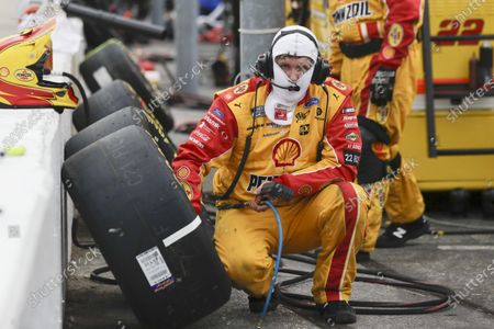 The tires for driver Joey Logano are checked during the NASCAR Cup Series auto race, in Darlington, S.C