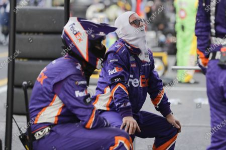 Stock Photo of Pit crews members for driver Denny Hamlin watch during the NASCAR Cup Series auto race, in Darlington, S.C