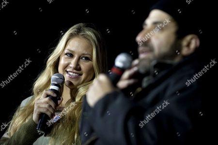 Tennis star Anna Kournikova and comedian Dave Attell perform
