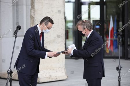 Polish Prime Minister Mateusz Morawiecki (L) and German ambassador to Poland Rolf Nikel (R) attend a handover ceremony a piece of the Berlin Wall to the Museum of John Paul II and Primate Wyszynski, as part of celebrations the 100th birth anniversary of the Pope John Paul II in Warsaw, Poland, 18 May 2020. Pope John Paul II born as Karol Jozef Wojtyla on 18 May 1920 in Wadowice, was head of the Catholic Church and sovereign of the Vatican City State from 1978 to 2005.
