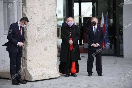 (L-R) Polish Prime Minister Mateusz Morawiecki, Metropolitan of Warsaw, Cardinal Kazimierz Nycz and German ambassador to Poland Rolf Nikel attend a handover ceremony a piece of the Berlin Wall to the Museum of John Paul II and Primate Wyszynski, as part of celebrations the 100th birth anniversary of the Pope John Paul II in Warsaw, Poland, 18 May 2020. Pope John Paul II born as Karol Jozef Wojtyla on 18 May 1920 in Wadowice, was head of the Catholic Church and sovereign of the Vatican City State from 1978 to 2005.