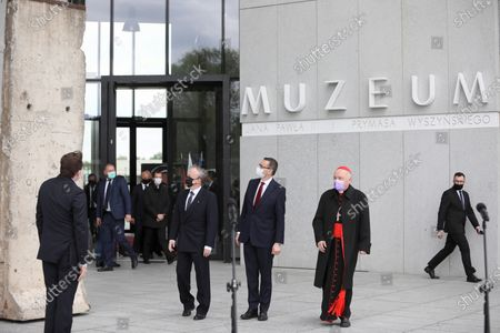 Polish Prime Minister Mateusz Morawiecki (C), Metropolitan of Warsaw, Cardinal Kazimierz Nycz (2R) and German ambassador to Poland Rolf Nikel (2L) attend a handover ceremony for a piece of the Berlin Wall to the Museum of John Paul II and Primate Wyszynski, as part of celebrations the 100th birth anniversary of the Pope John Paul II in Warsaw, Poland, 18 May 2020. Pope John Paul II born as Karol Jozef Wojtyla on 18 May 1920 in Wadowice, was head of the Catholic Church and sovereign of the Vatican City State from 1978 to 2005.