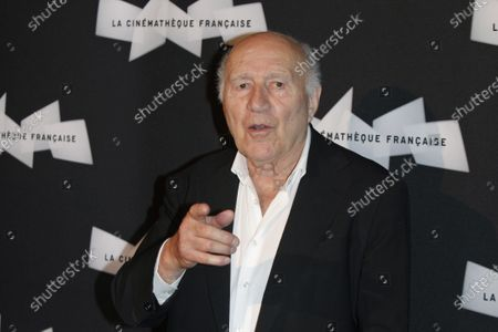 French actor Michel Piccoli gestures as he poses for photographers, during a retrospective of his career, in Paris. Michel Piccoli, a prolific screen star whose served as muse to filmmaker Luis Bunuel and was a leading man for Jean-Luc Godard, has died. He was 94