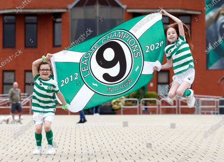 Young Celtic fans Evie Thompson (7) and Layla Hastie (9) celebrate outside Celtic Park in Glasgow, Britain, 18 May 2020, after the club was confirmed Scottish league champions, their 9th win in a row. The Scottish Professional Football League (SPFL) announced that Celtic was proclaimed champion after the Scottish Premiership 2019-2020 season has been declared over with immediate effect due to the ongoing coronavirus COVID-19 pandemic.