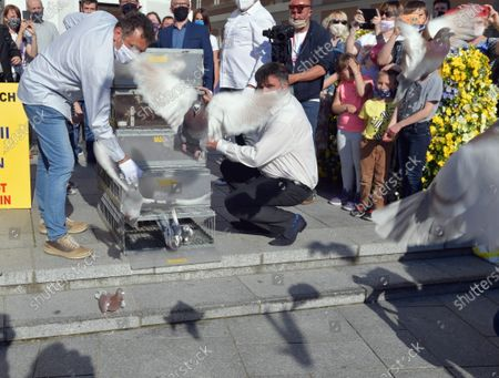 Stock Image of Residents of Wadowice participate in action '100 pigeons for the century' during the celebrations the 100th birth anniversary of the Pope John Paul II in Wadowice, Poland, 18 May 2020. Pope John Paul II was born as Karol Jozef Wojtyla on 18 May 1920 in Wadowice. He was head of the Catholic Church and sovereign of the Vatican City State from 1978 to 2005, and canonised on 27 April 2014.